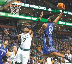 ORLANDO MAGIC guard E'Twaun Moore, right, drives to the basket against Boston Celtics forward Jared Sullinger (7) during the second half of an NBA basketball game in Boston on Monday. The Celtics defeated the Magic 120-105.