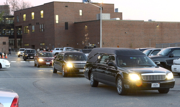 A motorcade departs after the memorial service for Brendan Conway, a former Deering High athlete who died Thursday while playing basketball.
