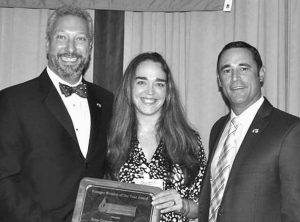 FROM LEFT, are Dave Polcari, incoming NEWWA president; Amy Coppers-Costantino, and Louis Schoolcraft, chairman of the Young Professionals Award Committee.