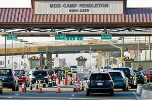 VEHICLES file through the main gate of Camp Pendleton Marine Base on Wednesday at Camp Pendleton, Calif. Four Marines were reported killed Wednesday in an accident while clearing an unexploded ordnance.