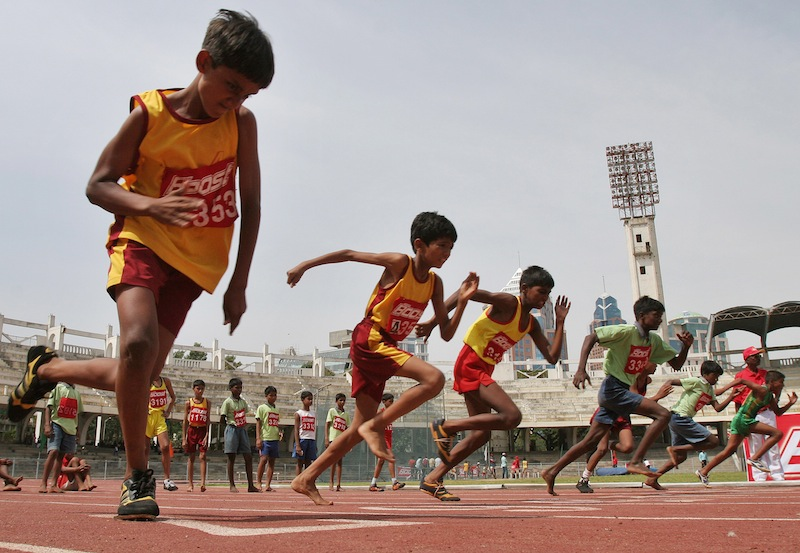In this May 13, 2007 file photo, boys participate in a 100-meter race during the two-day World Athletics Day meet in Bangalore, India. An analysis of studies on 250 million children around the world finds they don't run as fast or as far as their parents did when they were young. Research featured at the American Heart Association's annual conference Tuesday showed that on average, children 9 to 17 take 90 seconds longer to run a mile than their counterparts did 30 years ago.