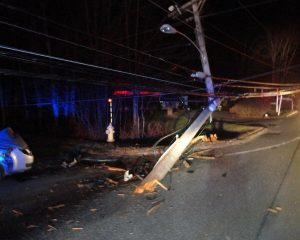 A car crashed into a utility pole near the corner of Route 196 and Ivanhoe Drive in Topsham Tuesday night. COURTESY OF TOPSHAM POLICE DEPARTMENT