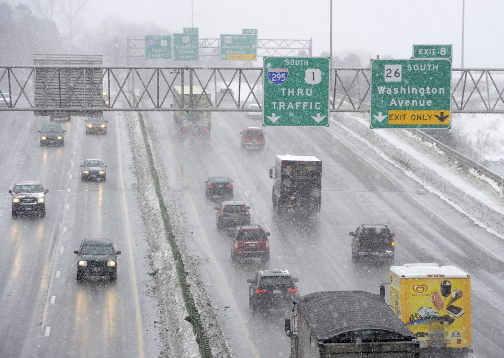 Afternoon traffic on Tukey's Bridge in Portland moves smoothly Tuesday at the start of the latest snowstorm to hit southern Maine.
