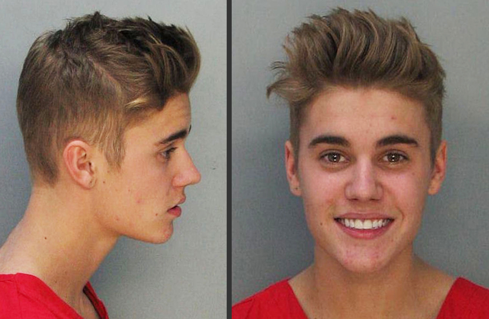 Justin Bieber is shown in mugshots after his arrest Jan. 23. Media outlets are urging a judge to grant access to police videos made shortly after the pop star's arrest.