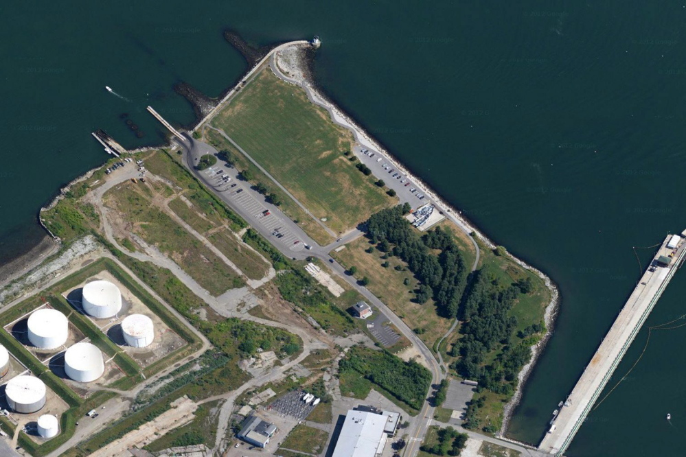 L+R Northpoint, a holding company of PK Realty Management, has purchased 30 acres of former shipyard property in South Portland. In this 2014 file photo, a portion of the property appears just above and to the right of the oil tanks. Bug Light Park is at top in photo.