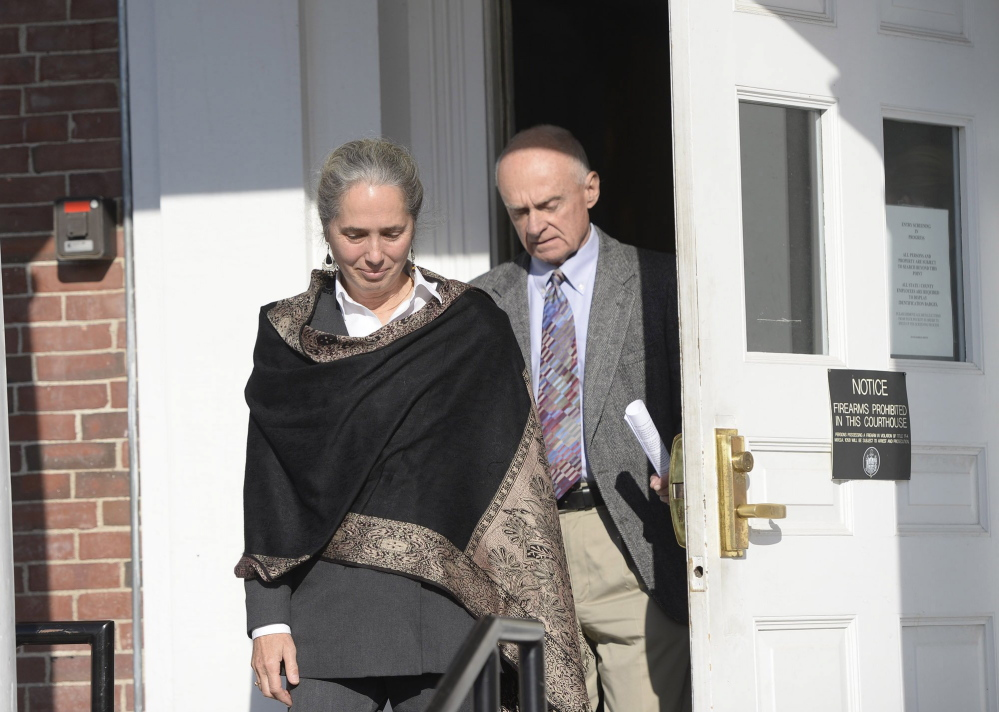 Jan Collins and Irving Faunce, adoptive parents of Gordon Collins-Faunce, leave York County Superior Court in 2013.