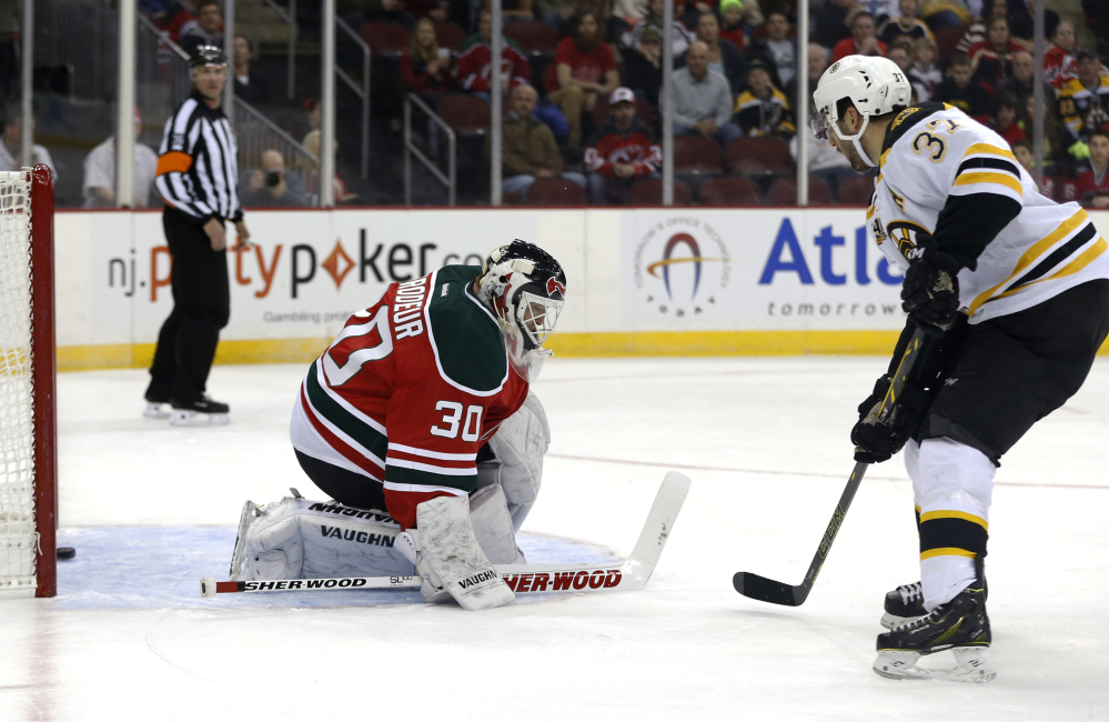 Bruins, Marchand beat Devils for 10th straight win