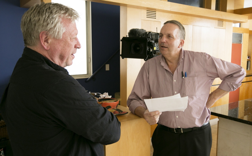 """Producer Robert Erickson, right, who will travel to Portland on Wednesday to do interviews for a documentary on the 24 hours before the Sept. 11 attacks, talks with Terry McDermott, author of """"Perfect Soldiers: The 9/11 Hijackers: Who They Were, Why They Did It."""""""