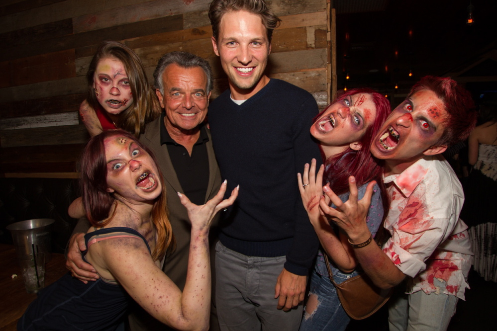 Kyle Rankin, center, with actor Ray Wise and undead friends.