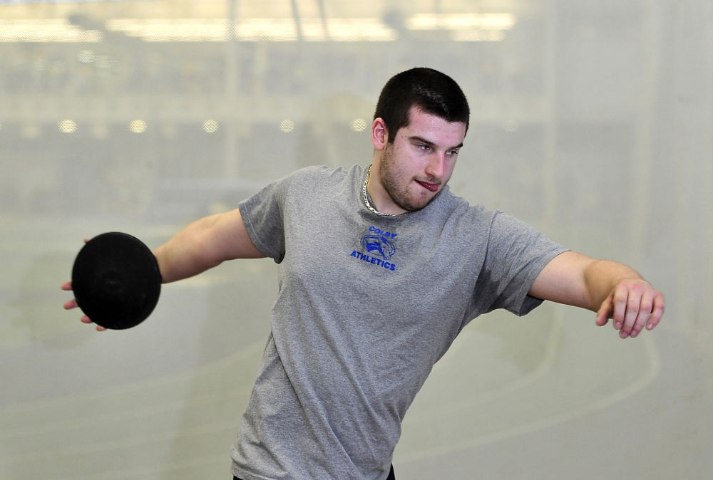 "Billy Parker works on his discus-throwing form at Alfond Athletic Center at Colby College last month. Parker, who started playing football as a third-grader in Massachusetts, suffered a concussion during a football practice at Colby last fall and says, ""I'm not 100 percent of the way to where I was before the injury."""