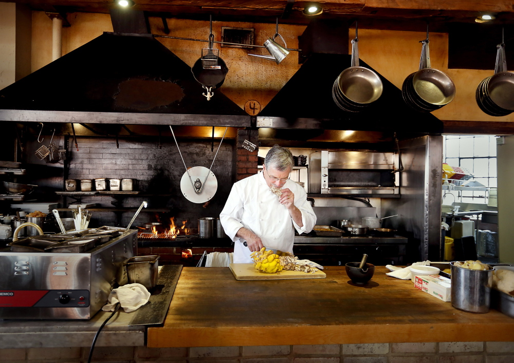 Sam Hayward chef and co-owner of Fore Street smells a hen of the woods mushroom.