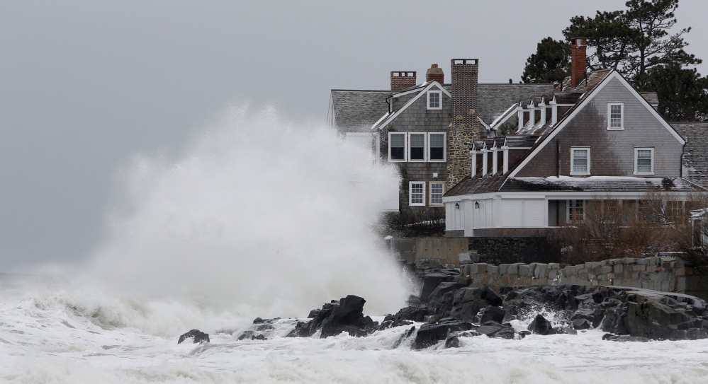 Waves crash into a house in Kennebunk in March 2013, a day when strong surf caused coastal flooding in some York County towns.