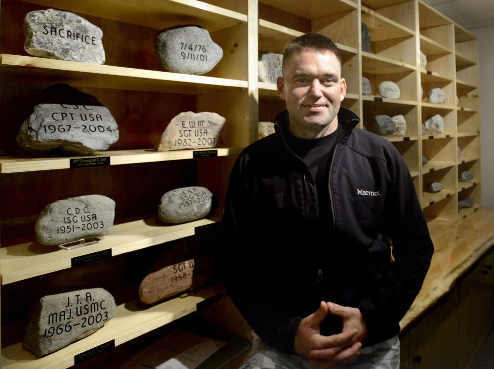 Waterville native Maj. David Cote, now a budget analyst for the Marine Corps, will lead a group of hikers who will carry engraved stones up Owl Mountain in honor of Mainers who have died since Sept. 11, 2001.