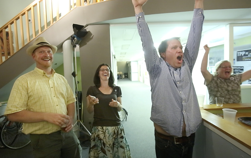 "Volunteer Chris Moore, right, celebrates the win by the Yes on 1 campaign in Portland on Tuesday night, joined by his wife, Bree LaCasse, center, and City Councilor David Marshall. ""We hope city officials heard us loud and clear,"" LaCasse said. Gregory Rec/Staff Photographer"
