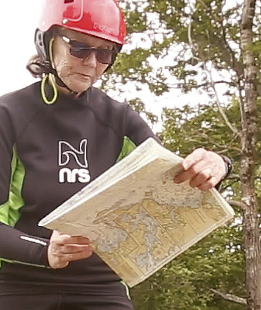 Deb Walters looks at a chart before paddling at Birch Point State Park in Owls Head. Her yearlong trip will start in Yarmouth and end in Guatemala City.