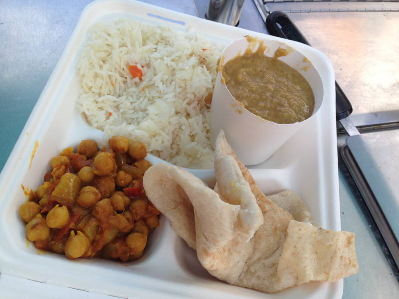 A thali plate with chana masala and dal.