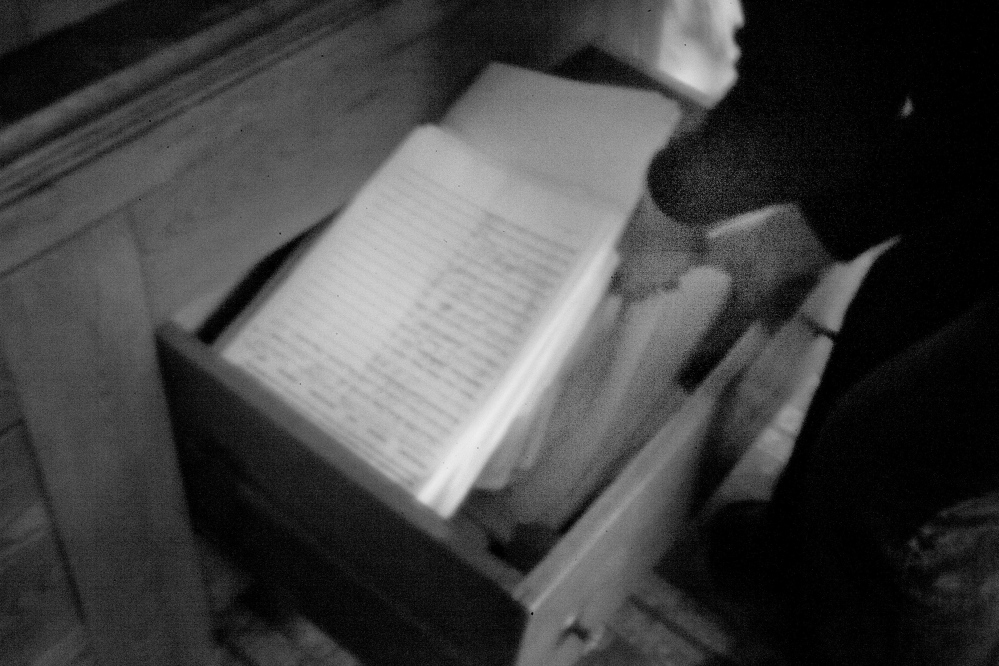 A Passamaquoddy elder and a member of the joint tribal council sifts through stacks of petitions at Pleasant Point. in an unexpected development, an exception clause in the land claims settlement led to some uncertainty about which laws should apply to Maine tribes.