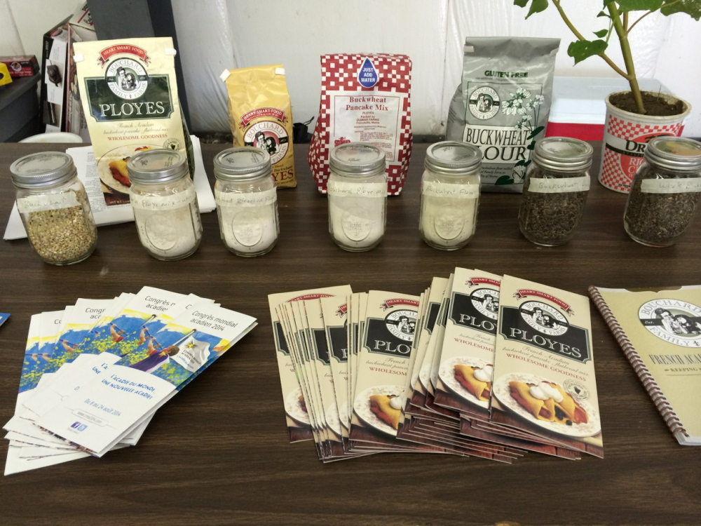 Mixes, ingredients and pamphlets populate a display about making ployes at the Kneading Conference in Skowhegan.