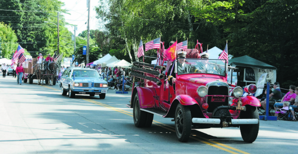 Fire officials lead the parade at a Wilton Blueberry Festival. The annual event started with a Blueberry Church Bazaar and grew into the two-day festival with thousands of attendees.