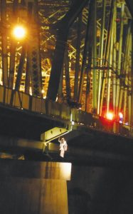 ERIC WALLACE, 27, can be seen just below the Frank J. Wood Bridge early Saturday morning. Wallace was taken into custody by police following a long standoff.