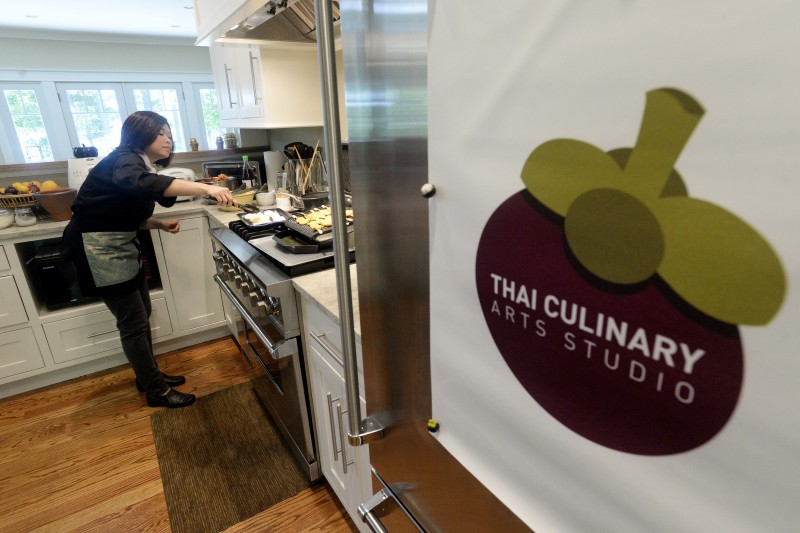 Watcharee Limanon prepares Thai dishes at the Thai Culinary Arts Studio on Cousins Island in Yarmouth.
