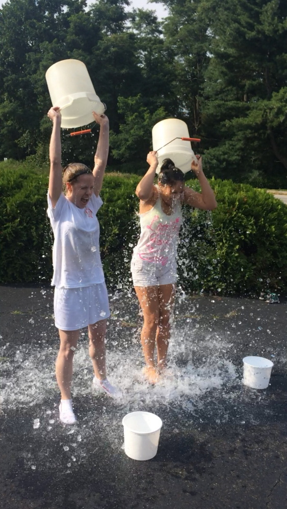 Jillian St.Louis and at right Danna Vaughn, taking the ice bucket challenge. Courtesy of Jennifer St.Louis