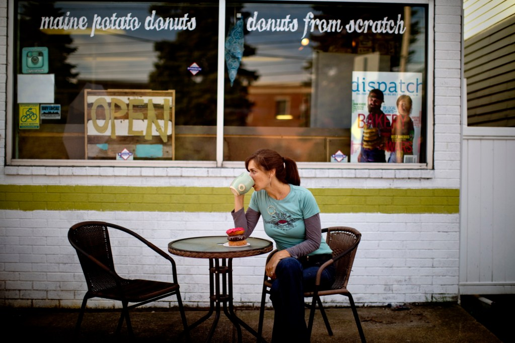 Leigh Kellis, owner of The Holy Donut on Park Avenue in Portland, sits in front of a stack of three varieties in 2014.