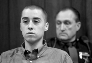 T. J. LANE LISTENS during court proceedings in Geauga County Common Pleas Court in Chardon, Ohio, in this Feb. 26, 2013 file photo. Ohio police said yesterday that Lane, 19, the convicted killer of three students at a high school cafeteria, escaped from prison and a search is underway.