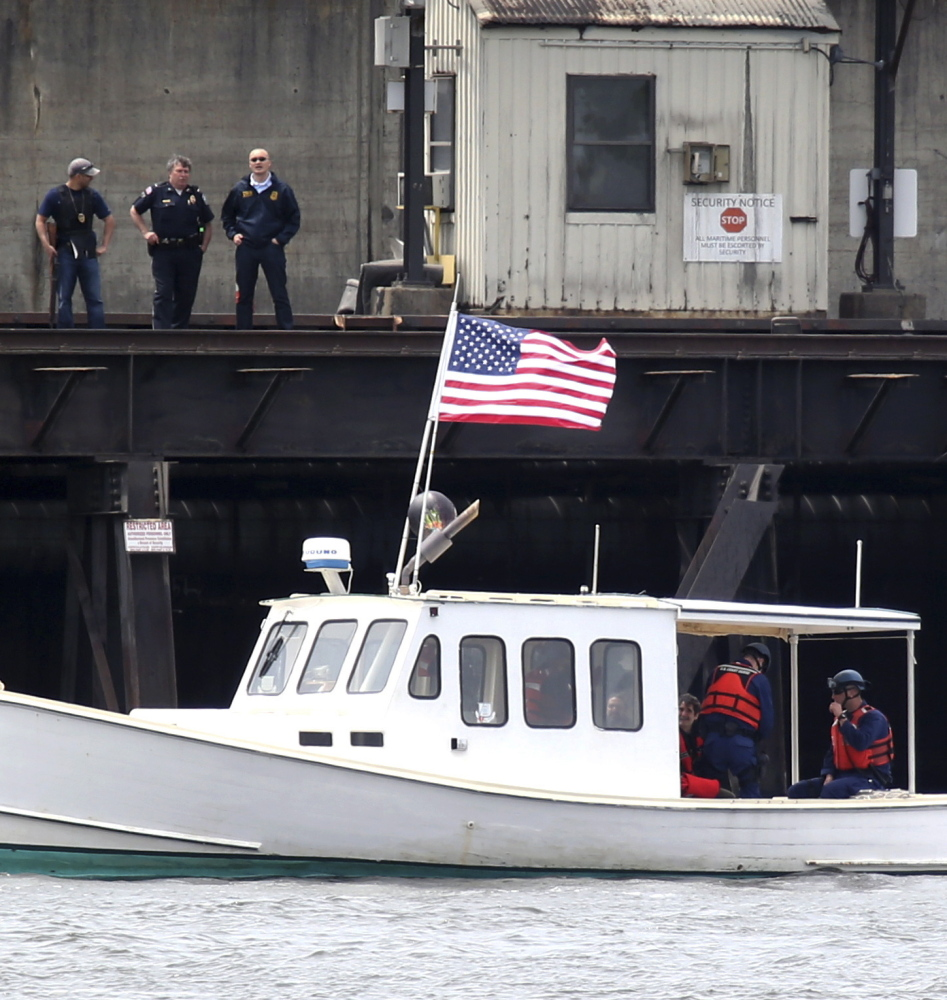 The lobster boat Henry David T., attempts to block delivery of coal to the Brayton Point Power Station in Somerset, Mass., in 2013. A trial begins this week in Fall River District Court for Ken Ward and Jay O'Hara, the two environmental activists who used the boat to block a coal shipment.