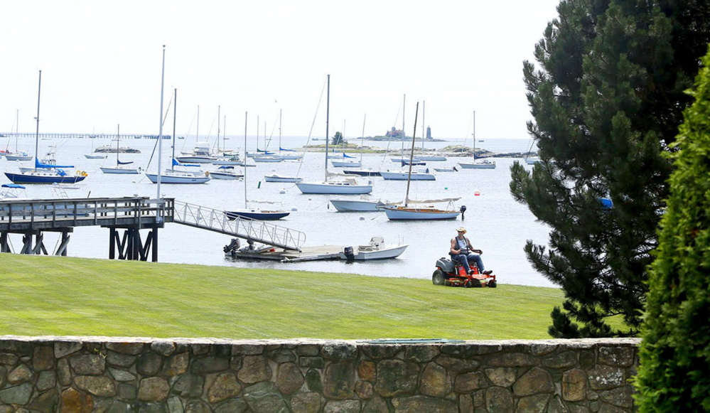 Owners of waterfront property, like this one in Kittery Point, are advised by environmental specialists not to fertilize much, if at all, and to avoid using weed killers and insecticides, which damage the waterway and the life in it.