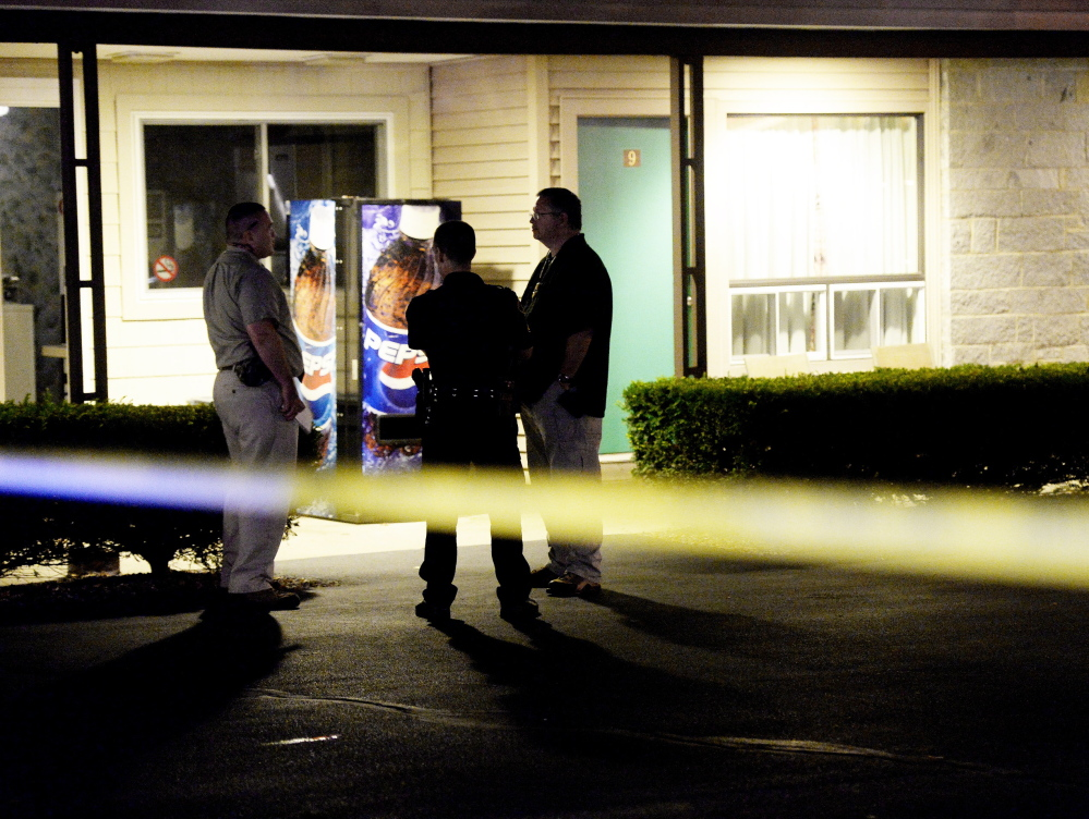 Biddeford police and a Maine State Police detective investigate the discovery of two bodies in a room at the Sleepy Hollow Motel in Biddeford on Tuesday night.