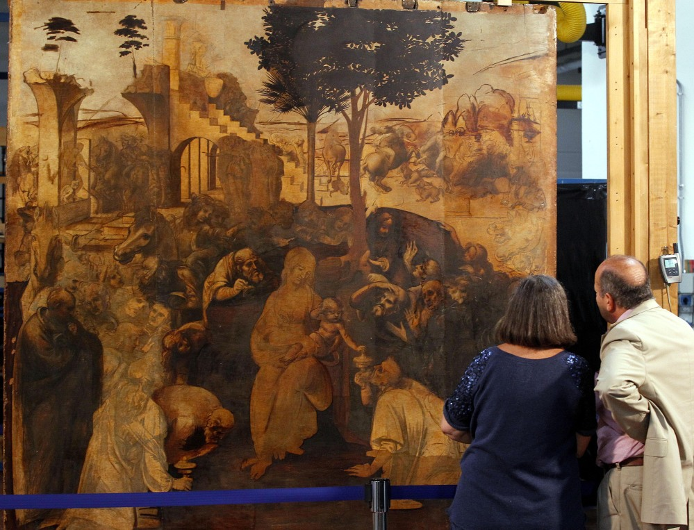 "People look at one of Leonardo da Vinci's most famous works, ""Adoration of the Magi,"" during a press conference in Florence, Italy, Tuesday."