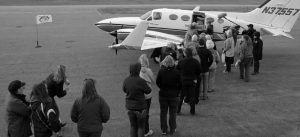 THE PUBLIC GREETS A PLANE full of shelter dogs at the Coeur d'Alene airport in Idaho in the new episode,