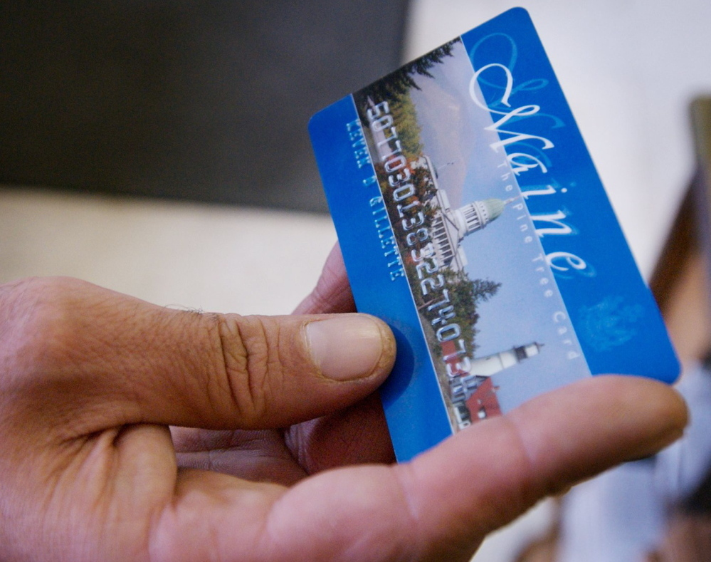 A Portland man uses a magnetic food stamp card to buy his groceries in August 2008.