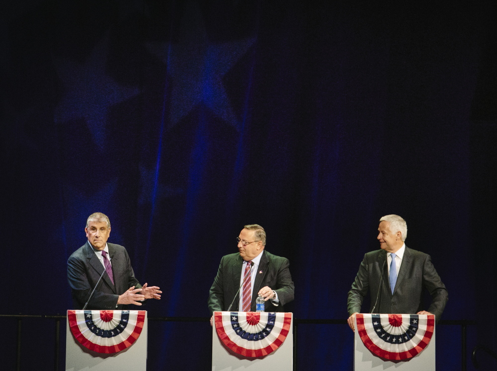 """AUGUSTA, ME - OCTOBER 15: Independent candidate Eliot Cutler  responds to current governor and Republican candidate Paul LePage during the Maine State Chamber's Gubernatorial Forum at the Augusta Civic Center in Augusta, ME on Wednesday, October 15, 2014. """"You say that you've created 20 to 22,000 jobs, and you're proud of that. That's like saying the Red Sox had a good year because they won 71 games,"""" Cutler said. (Photo by Whitney Hayward/Staff Photographer)"""
