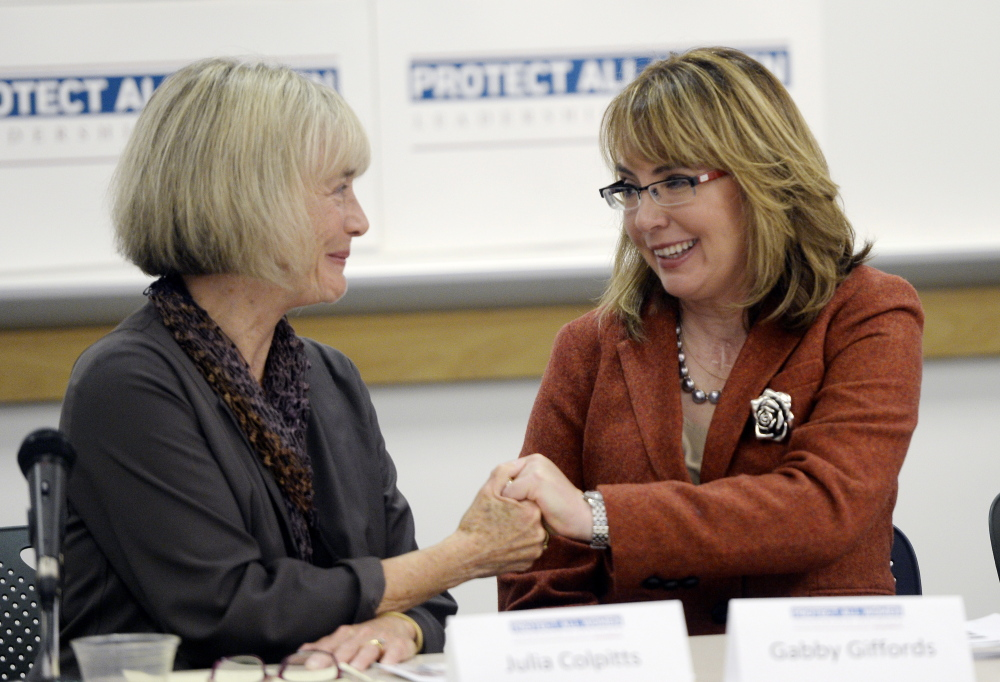 Julia Colpitts, executive director of the Maine Coalition to End Domestic Violence, left, and former Democratic U.S. Rep. Gabby Giffords of Arizona share a moment during Gifford's visit to the University of Southern Maine as part of her Protect All Women Tour in October.