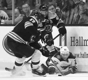MINNESOTA WILD right wing Nino Niederreiter (22) Boston Bruins left wing Milan Lucic (17) and center David Krejci (46) for the puck in the first period of an NHL hockey game in Boston on Tuesday. The Wild won, 4-3.
