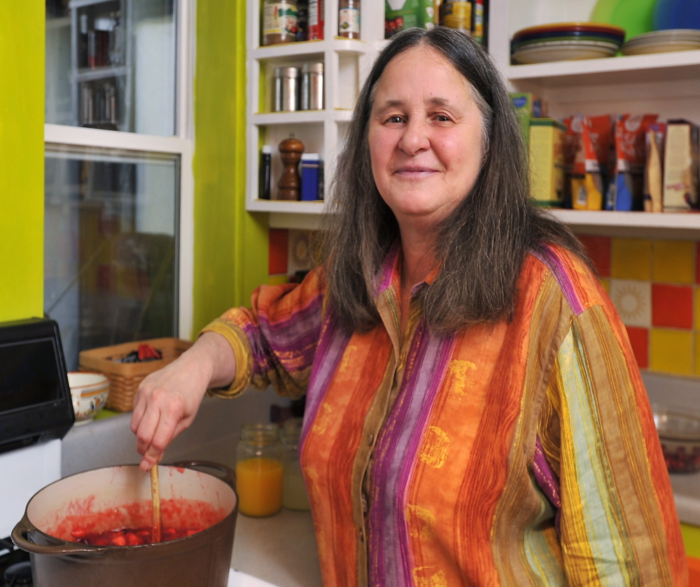 Author Ellen Cooney makes cranberry sauce at her home in Phippsburg.