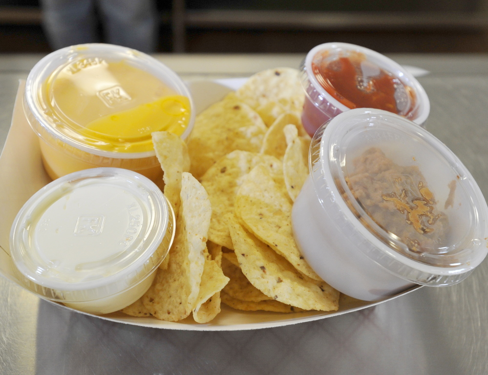 Nachos with cheese, sour cream, salsa and pinto beans are a vegetarian entrée at Kennebunk High.