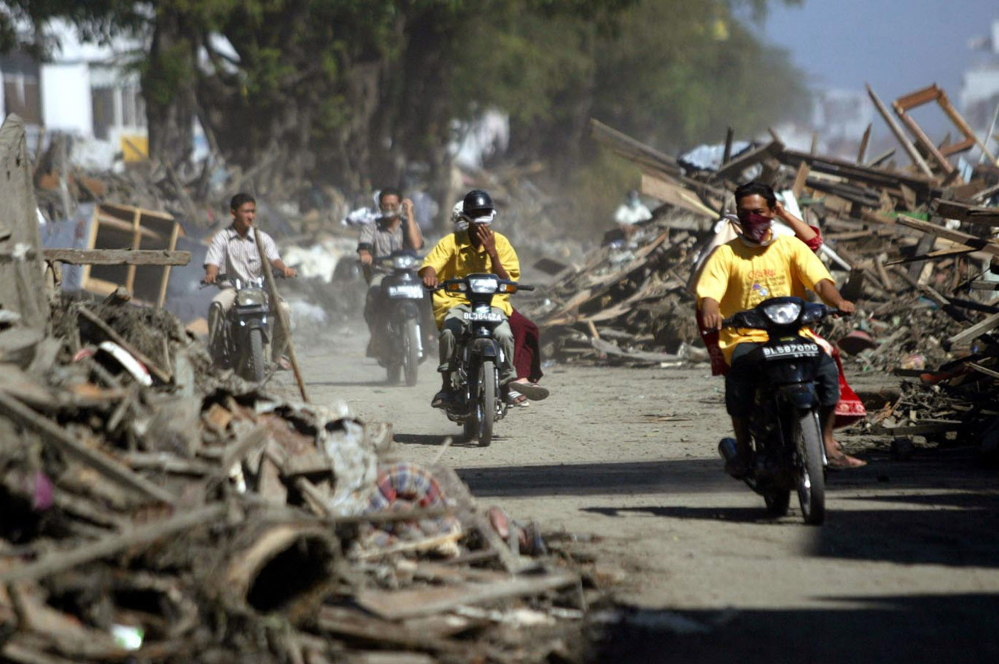 Cleanup of rubble from 2004 tsunami in Banda Aceh, Indonesia, leaves