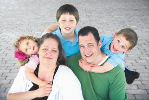 JENICA AND KEITH BARRY are shown with their children, from left, Leah, Zack and Luke.