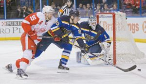 DETROIT RED WINGS' Niklas Kronwall (55) works against St. Louis Blues' Alexander Steen (20) for the puck in front of goalie Brian Elliott during the first period of an NHL hockey game on Thursday in St. Louis.