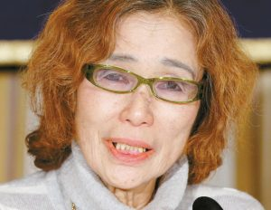 JUNKO ISHIDO, mother of Japanese journalist Kenji Goto who was taken hostage by the Islamic State group, speaks during a press conference in Tokyo, today.