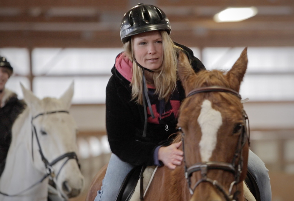 "Heather Fields, an inmate at the Southern Maine Re-entry Center, rides a horse at Carlisle Academy. Riding has shown her that there are things other than drugs ""that fill you up,"" she said."