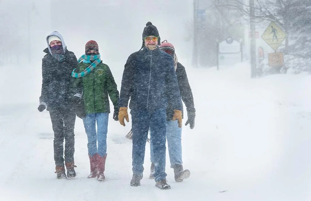 Jack Milton/Systems Editor Molly, Maeve, Christian and Tandy Ratliff walk home on Ocean Street in South Portland after having breakfast at a local coffee shop during the blizzard Tuesday.