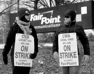 FAIRPOINT EMPLOYEES AMBER LYMAN, left, and Julie Sawtelle picket outside the Fairpoint offices in Portland in this Jan. 23 photo. Northern New England's primary landline provider, Fair- Point Communications, and two unions representing more than 1,700 workers announced Thursday, Feb. 19, that they had reached a tentative agreement to end the four-month strike.