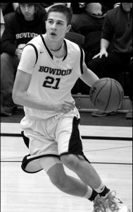 BOWDOIN COLLEGE forward Lucas Hausman dribbles to the hoop during a NESCAC game Friday against Bates at Morrell Gymnasium Hausman scored 44 points in a 98-70 win.