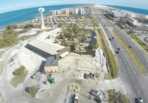 AN AERIAL VIEW of Okaloosa Island, Fla., looking east down U.S. Highway 98 shows the construction area where two new amusement projects are currently underway. In the late 1960s and into the1970s, this barrier island in northwest Florida was home to a popular amusement park with a Ferris wheel, a roller coaster and bumper cars. Two new projects underway on that property will return Okaloosa Island to its amusement park roots by bringing in zip lines, miniature golf, laser tag and other family-friendly activities.