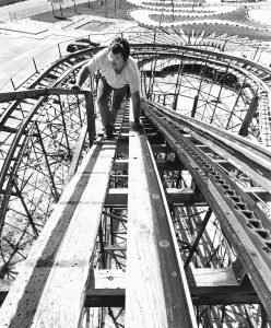 BRAD FLOM climbs to the top of a roller coaster on Okaloosa Island, Fla., to make repairs in this photo from the mid-1980s.