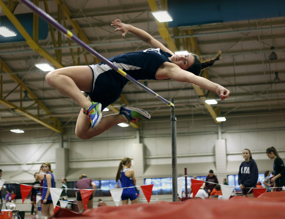 FEB. 16 CLASS B GIRLS INDOOR TRACK Emma Egan of Yarmouth sets a state record in the high jump with this leap of 5 feet, 4  inches during the Class B indoor track and field championships at Bates College in Lewiston.